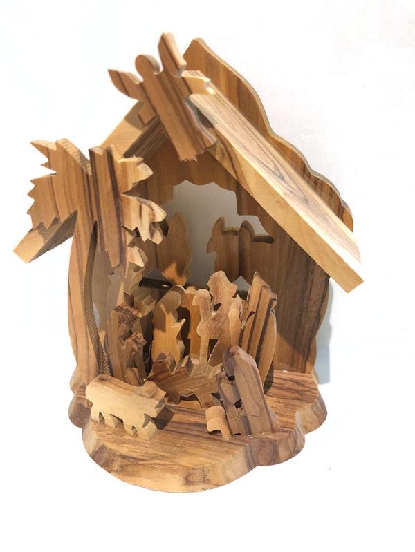 Presepe capanna con palma, pastori e angelo