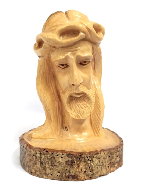 Testa di Cristo con base in corteccia
